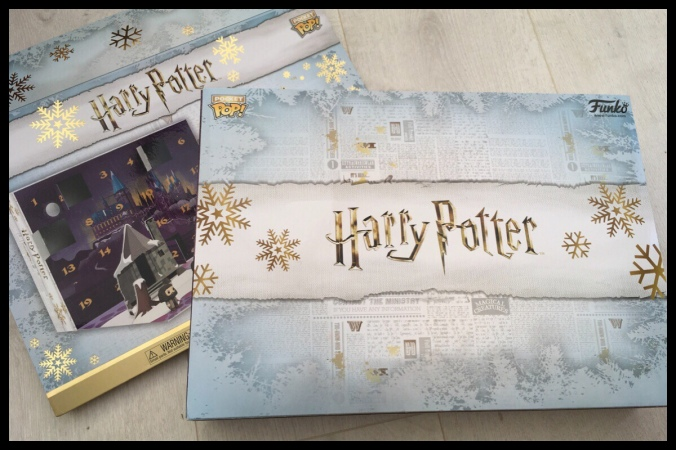 The outside box of the Harry Potter Funko Pop advent calendar with a white, grey and silver snowflake pattern