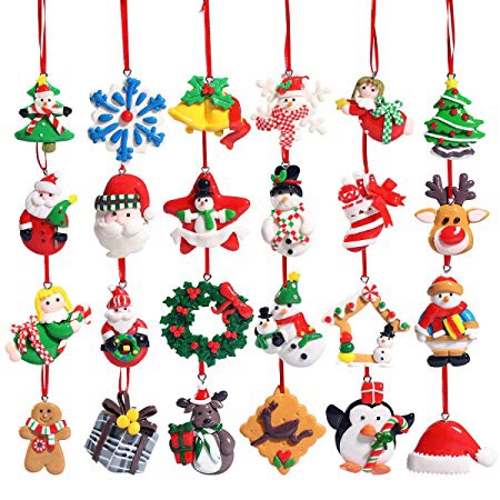 All 24 of the clay tree decorations in the advent calendar. It includes reindeer, gingerbread men, snowmen, Santa and other Christmas themed designs.