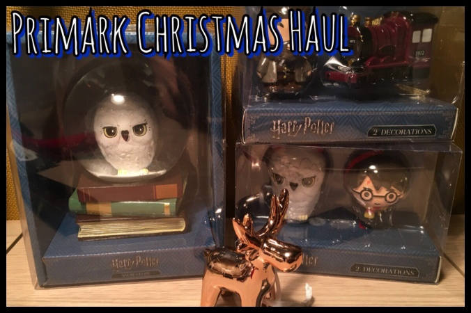 A picture of a selections of Christmas decorations from Primark, three Harry Potter and one rose gold moose