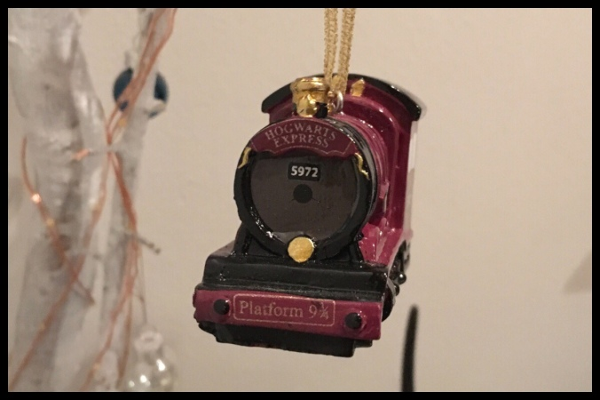 A picture of the front of the Hogwarts Express Christmas decoration, it shows the Howard's Express written at the top and Platform 9 3/4 along the bottom