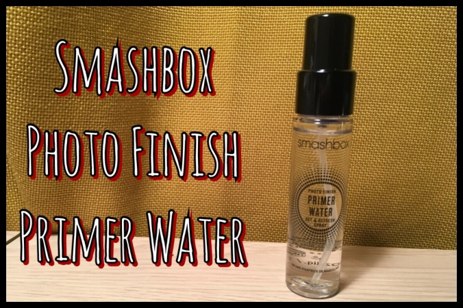 Title image with a photo of the Smashbox Photo Finish primer water bottle in front of a yellow curtain background