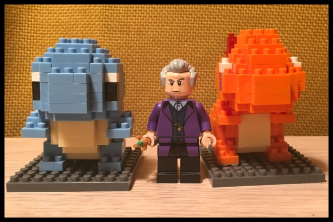 An image of the Squirtle and Charmander models built next to the Lego Doctor Who Eleventh Doctor figure for scale. They aren't much bigger than it height wise.