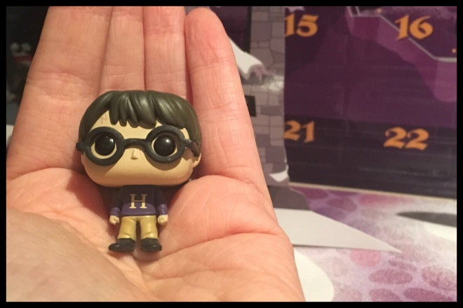 An image showing the Harry Potter figure in a hand for scale