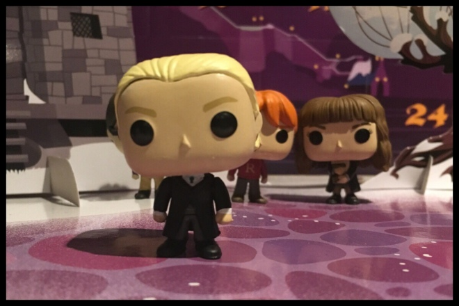 The Draco Malloy figure is stood in the foreground with the students from previous days in the background