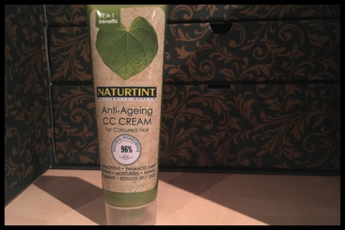 The tube of Naturtint CC Cream is stood in front of the drawers of the beauty advent calendar