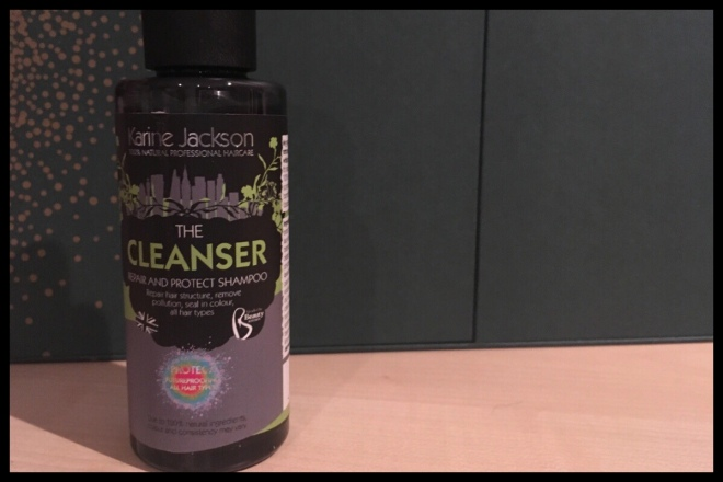 The front of the small 100ml bottle of the Beauty Kitchen Karine Jackson The Cleanser Shampoo