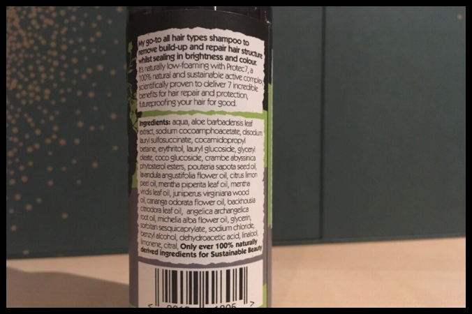 The back of the shampoo bottle with the ingredients and some information on the product