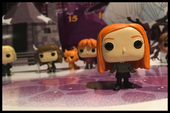 The Ginny Weasley figure is in the foreground with the previous student figures out of focus in the background