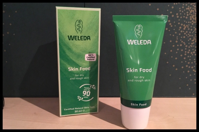 The tube of Weleda Skin Food standing next to the box it came in