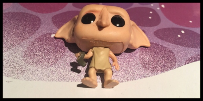 The Dobby figure laying down to show the detail in the sock and pillow case that he is wearing