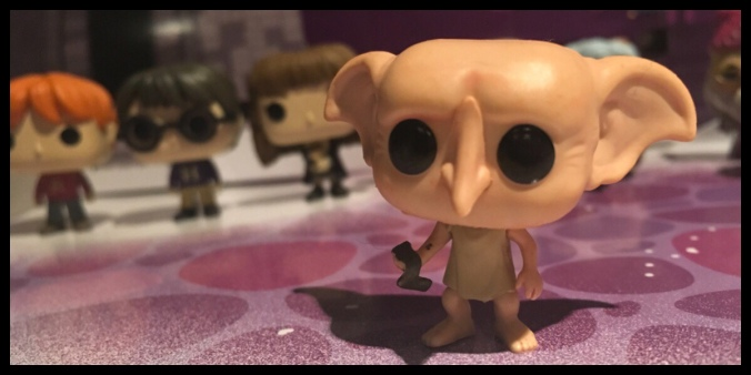 The Dobby figure is at the front with other characters from the advent calendar behind in the background.