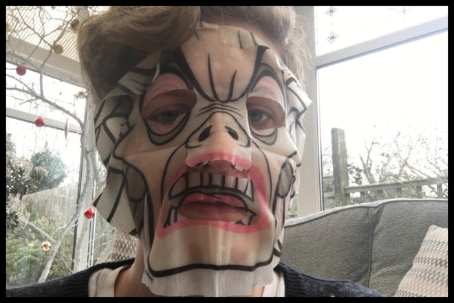 Me using the sheet mask, it fits well but looks a bit crazy with all the lines on it!