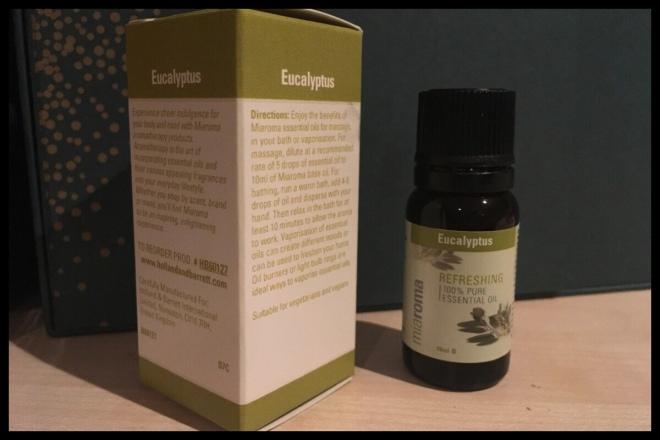 The Miaroma Eucalyptus Oil bottle next to the box.