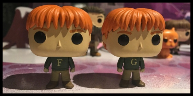 The two Funko Pop figures of the Weasley twins stood next to each other