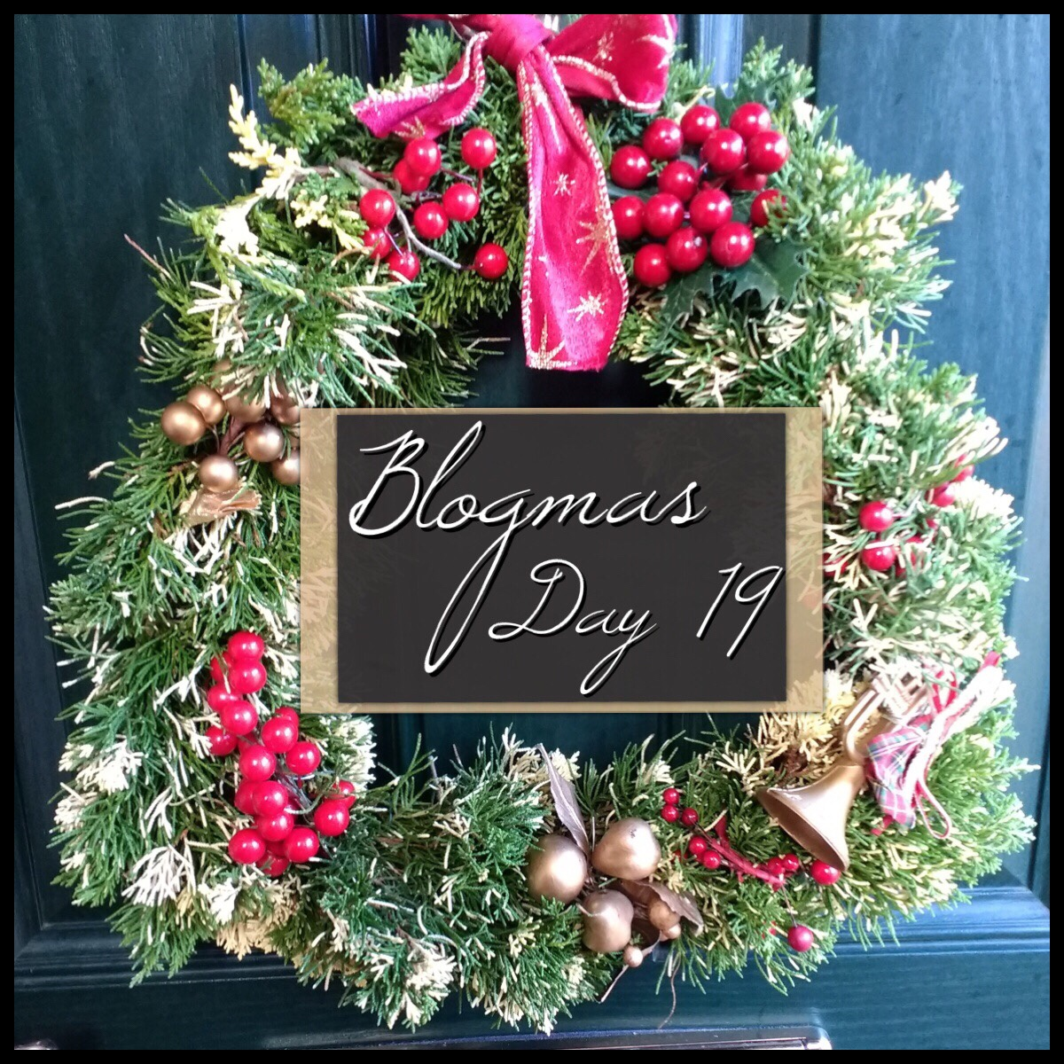 The Blogmas title image. It has a homemade wreath hanging on a door.