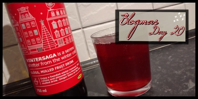 The Blogmas title image. It has a bottle of glögg with a glass full of it next to it