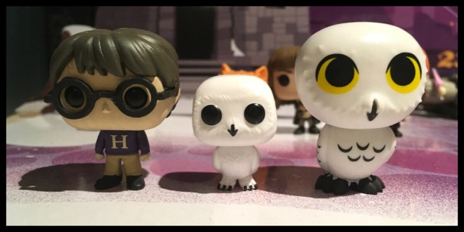 A size comparison between three figures. The Harry Potter from a previous advent day is on the left, today's Hedwig is in the middle and on the right is the Hedwig from the funko blind box collection