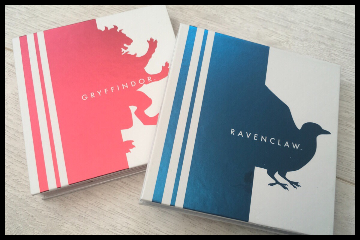 The front of the Harry Potter eyeshadow palettes. On the left is Gryffindor with a red lion and the right palette has Ravenclaw with a metallic blue raven