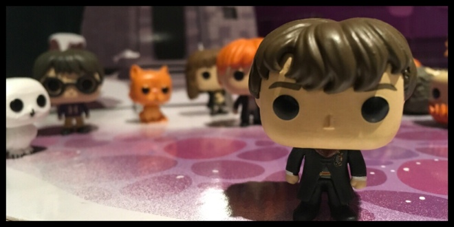 The Neville Longbottom figure in his Hogwarts robes