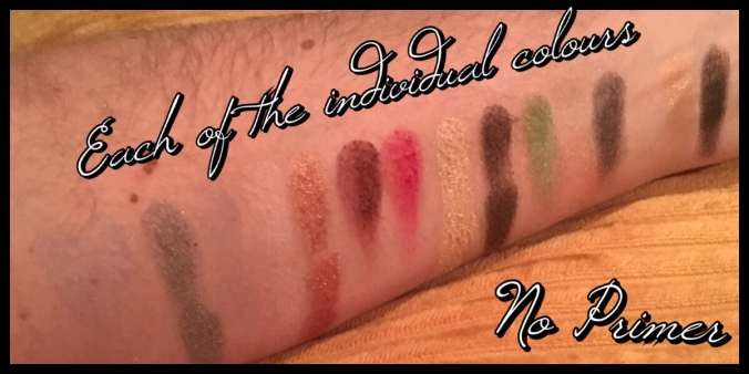 All sixteen eyeshadow side by side, there are some areas that look like glass where the weaker shadows are and some have two swatches next to each other for the duplicates.