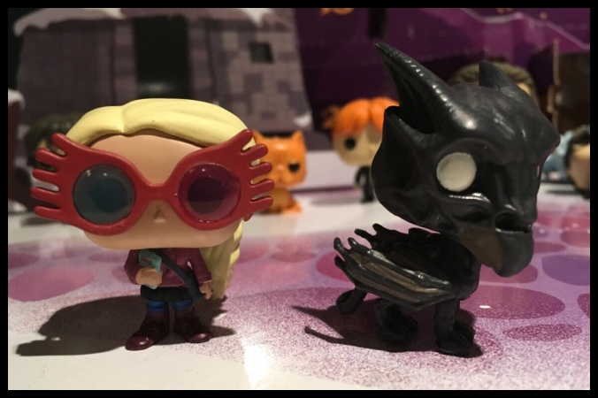 The Luna Lovegood figure next to the Thestral figure from the two days of the Funko Pop advent calendar