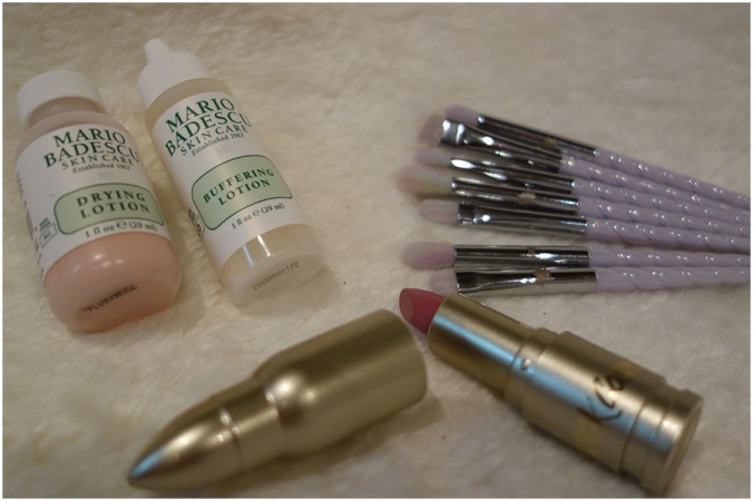 Left to right: The mini Drying Lotion and Buffering Lotion from Mario Badescu, the RPG liptick from LuantiCK Labs and the seven brushes in the Unicorn Cosmetics Class of 86 Brush set