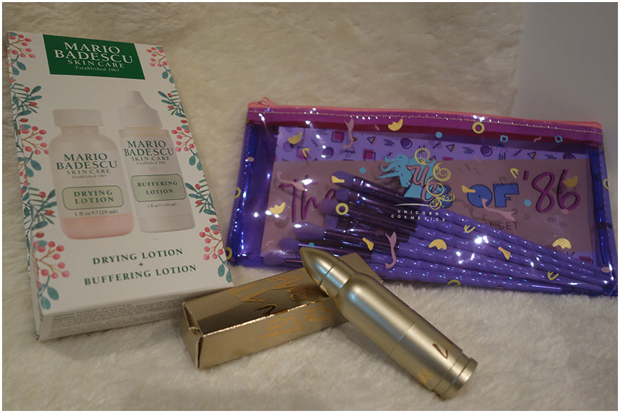 The products from Beauty Bay. Left to right: A Mario Badescu set with a mini drying lotion and buffering lotion, the LunatiCK Labs lipstick in RPG and the Class of 86 eye makeup brush kit from Unicorn Cosmetics