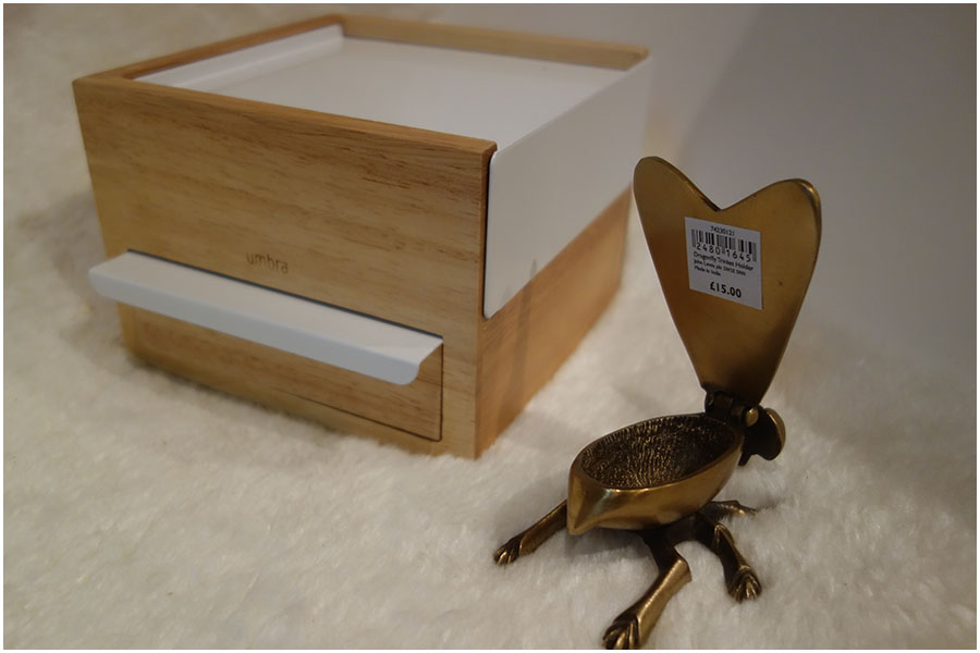 The jewellery box is closed up, the dragonfly trinket box is in fromt with the wings open showing the empty space for storage