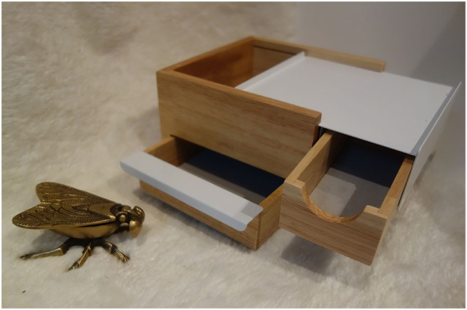 The Umbra Mini Stowit Jewellery Box is open, showing all of the compartments. Next to it the dragonfly trinkket box is closed