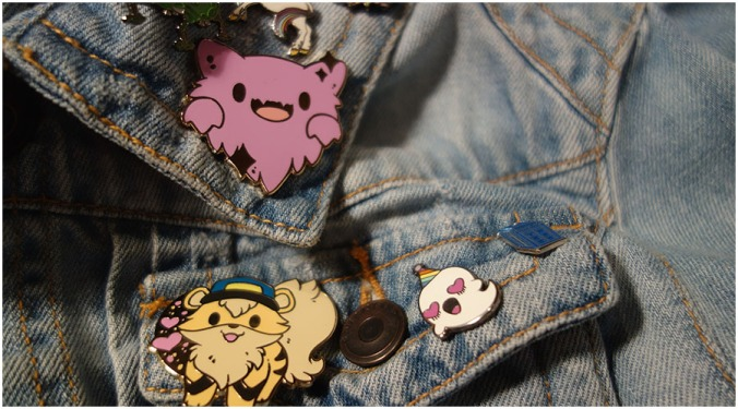 The Haunter and Growlithe pins on my denim jacket next to some of my other pins