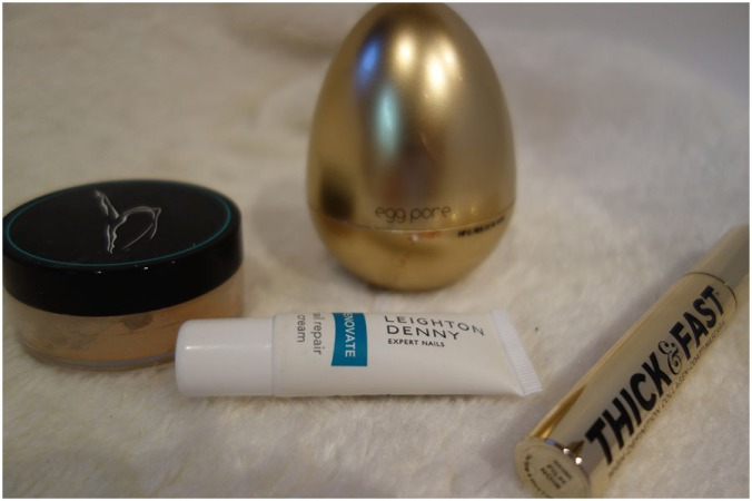 a jar of Beautiful Me Prime and Create Mixing Medium with the foundation mixed in, the Leighton Denny Nail Repair Cream, Tony Moly Egg pore Primer and a tube of Soap and Glory Thick and Fast Gold Mascara