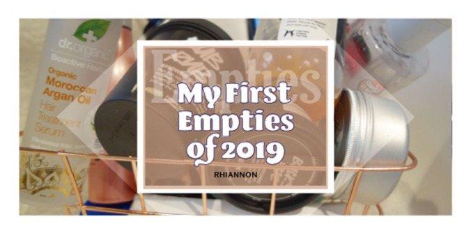 My First Empties of 2019 title image. Behind the text is a photo of a lot of empty bottles and jars in a rose gold basket