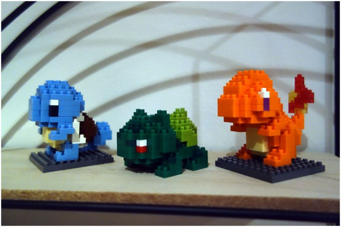 The Squirtle, Bulbasaur and Charmander models stood on a shelf