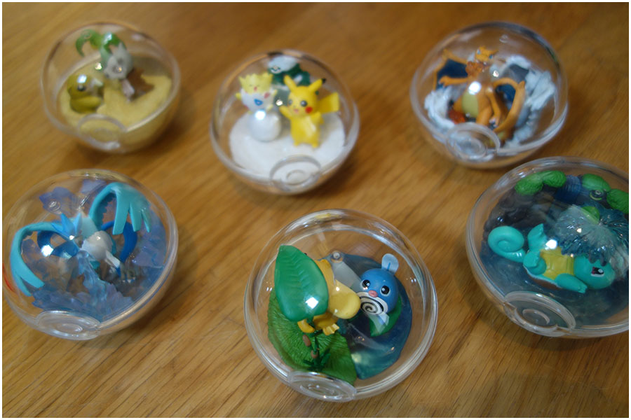 The complete Pokémon Re-ment terrariums with the lids on