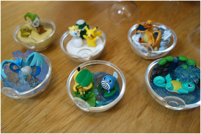 All six of the Pokémon terrarium designs with the lids off