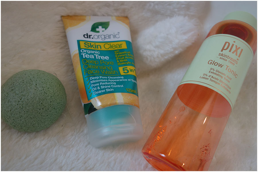 The Konjac sponge, Dr Organic Tea Tree face wash and Pixi Glow Tonic bottle.