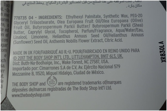 The text inside the label on the back of the tin. It shows the ingredients and information on the company