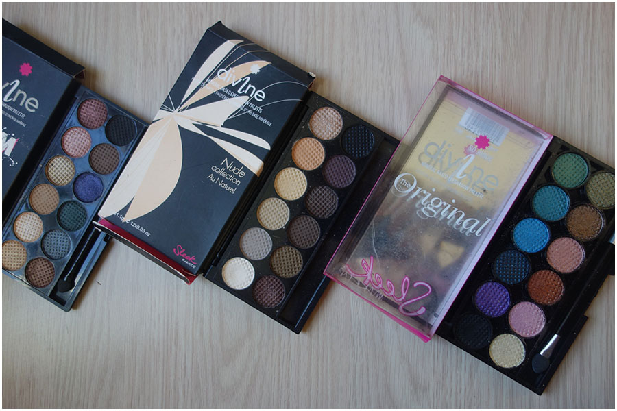 Three Sleek eyeshadow palettes open on a table, From left to right; Storm, Au Naturel and the Original Palette