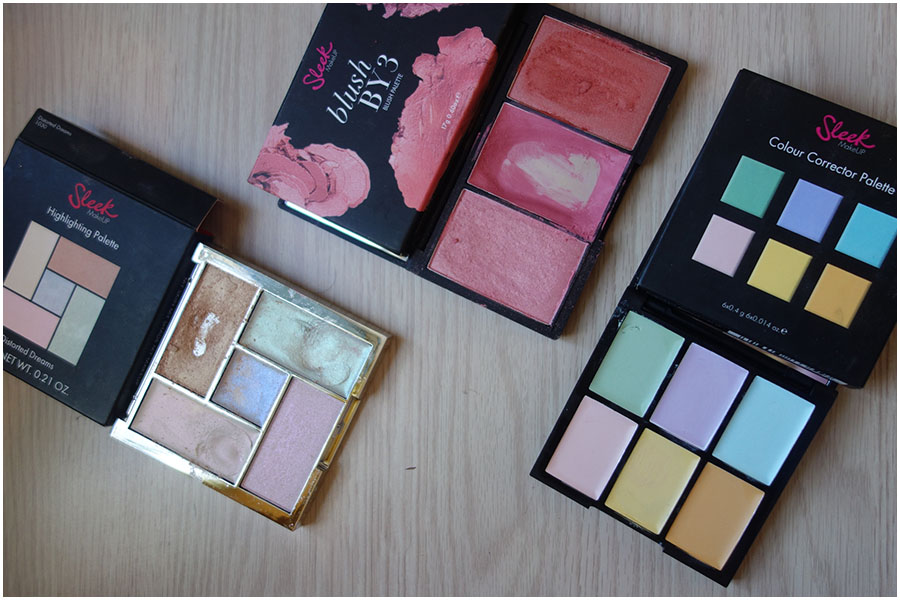Three sleek makeup palettes. Left to right: Highlighting Palette in Distorted Dreams, Blush by 3 in Pink Lemonade and the Colour Correction cream palette