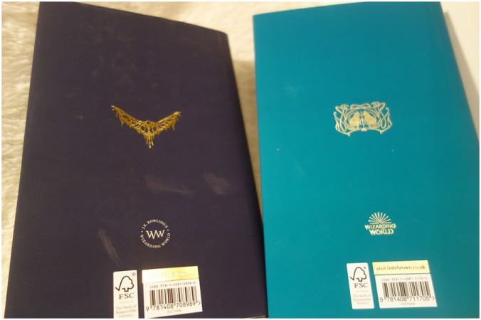 The back covers of Fantastic Beasts and Where to Find Them and the Crimes of Grindelwald. There are grease marks on the cover of Fantasic Beasts