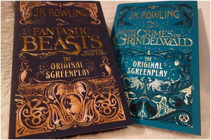 Fantastic Beasts and Where to Find Them and the Crimes of Grindelwald hardcover books, showing the front covers and the details of the designs