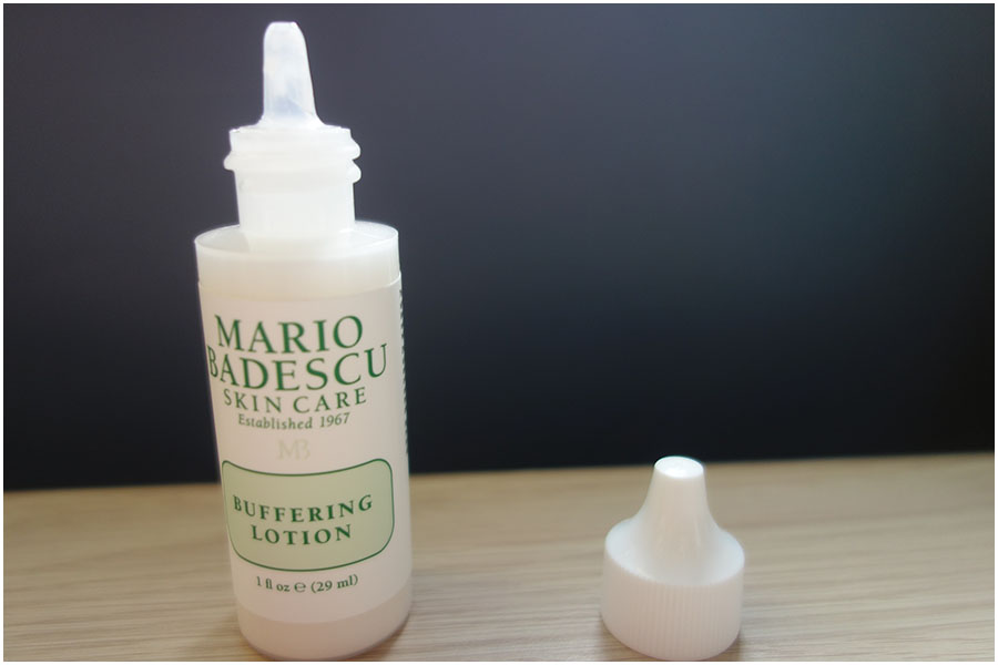 The Mario Badescu Buffering Lotion bottle. It is open, showing the dropper end you use for application.
