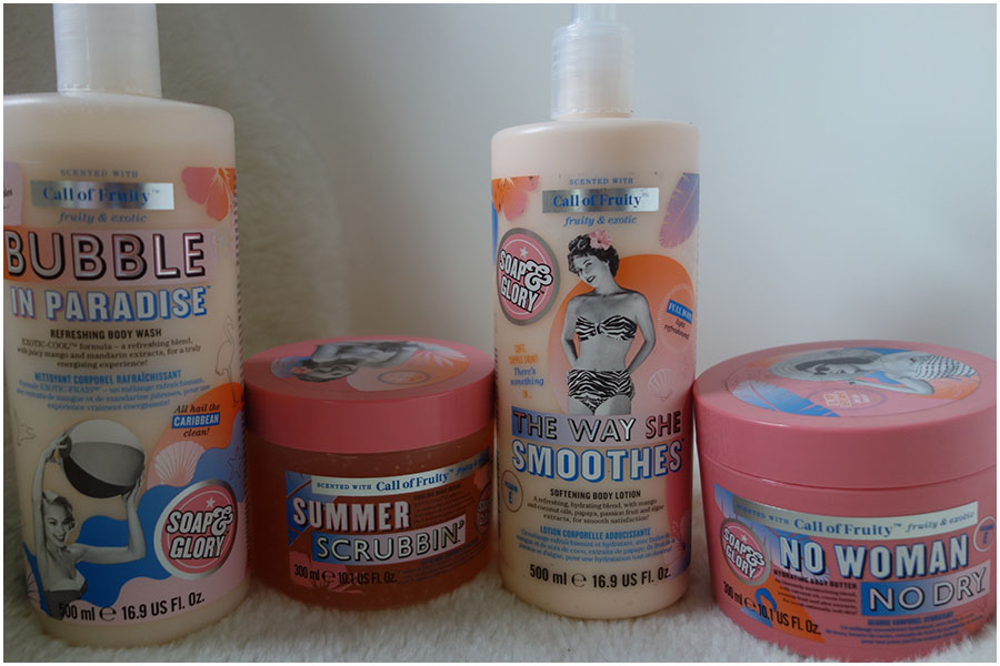 The four Soap and Glory Call Of Fruity products that I bought. From left to right: Bubble in Paradise body wash, Summer Scrubbin' body scrub, The Way She Smoothes body lotion and No Woman No Dry body butter.