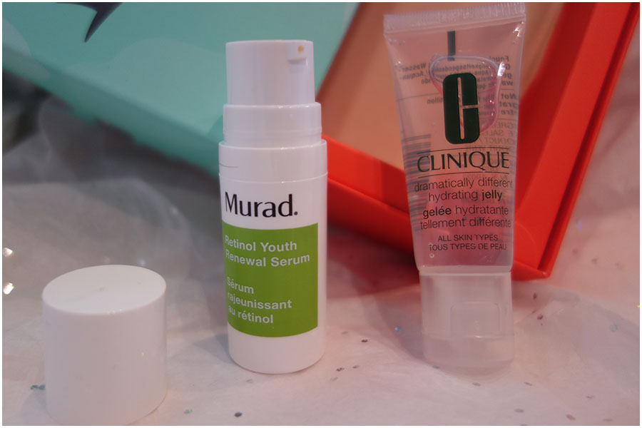 A photo of the Murad Retinol Youth Renewal Serum with the lid off to show the pump dispenser and the Clinique Dramatically Different Hydrating Jelly