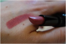 A swatch of the Lovecraft Kat Von D Studded Kiss Crème Lipstick.