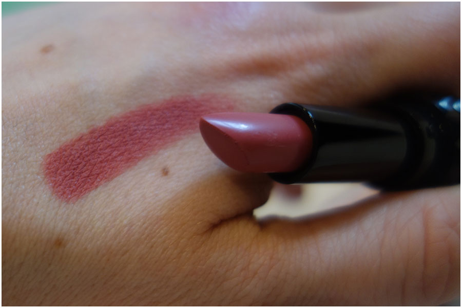 A swatch of the Lovecraft Kat Von D Studded Kiss Crème Lipstick.