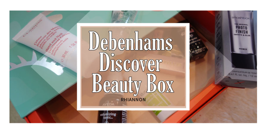 Debenhams Beauty Discovery Box title image. Behind the text is a photo of the drawer style box open with the products inside it.