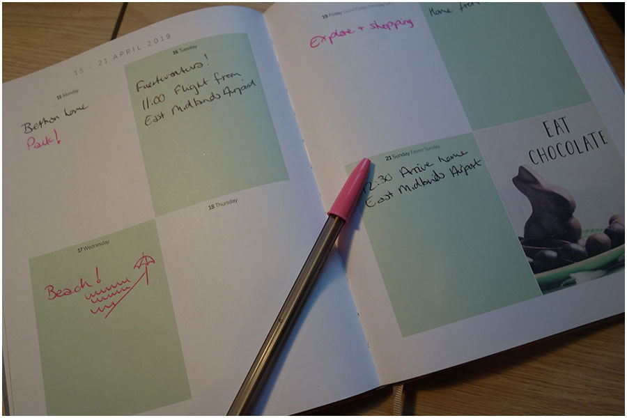 A double page from my diary. Inside it has the dates for the holiday along with notes for the beach day and shopping.