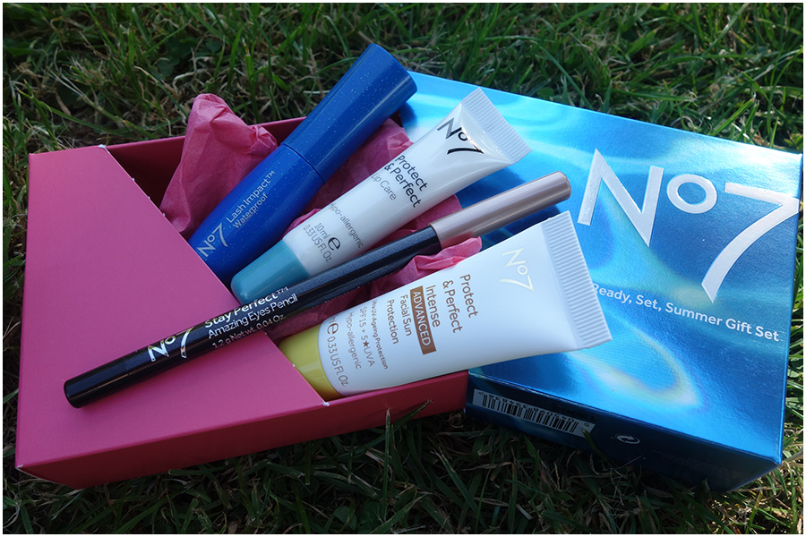 The box set that the products came in, with the products showing out of the side. There's the lash impact mascara, protect and perfect lip care, stay perfect eye pencil and protect and perfect intense advanced facial sun protection.