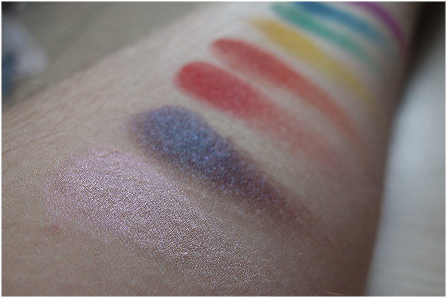 The swatches at an angle, showing the duochrome effect of the two larger eyeshadows